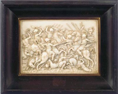 A CARVED IVORY RELIEF PLAQUETT