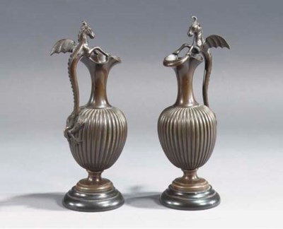 A PAIR OF BRONZE EWERS