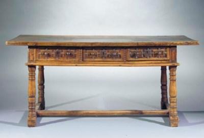 A Castillian walnut side table