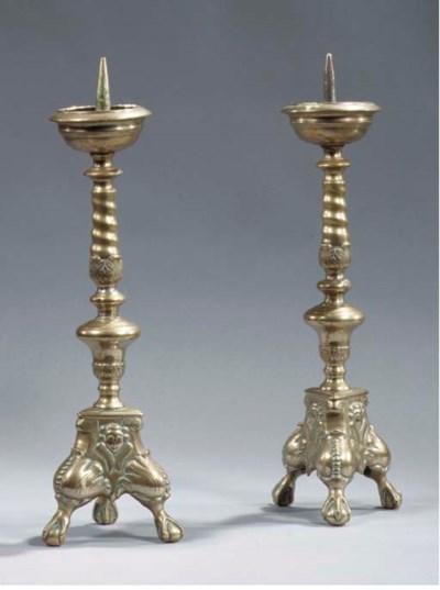 A pair of Flemish bronze prick
