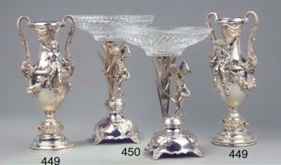 A pair of heavy silver cupid v