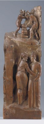A CARVED WOODEN RELIEF FRAGMEN