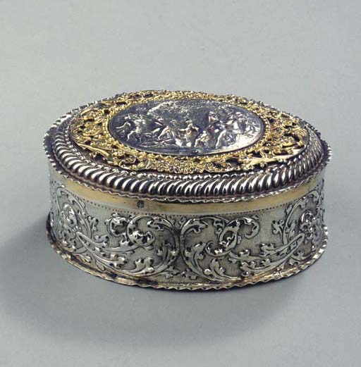 An oval silver and parcel-gilt