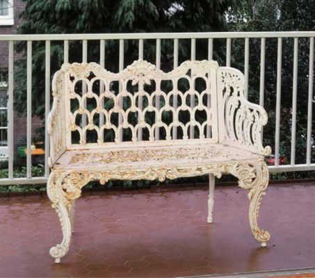 A white-painted cast-iron gard