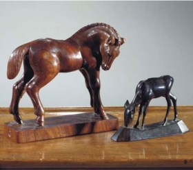 (2)  A Dutch carved rosewood figure of a horse