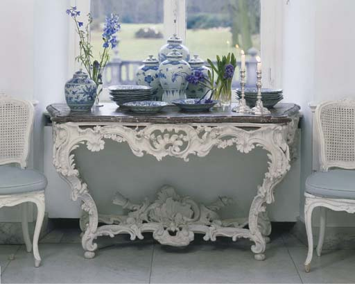 A LOUIS XV WHITE-PAINTED CONSO