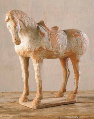 A RED POTTERY FIGURE OF A HORS