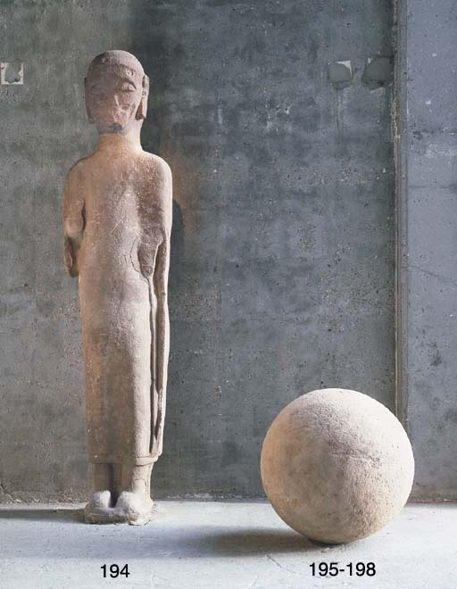 A SCULPTED STONE SPHERE