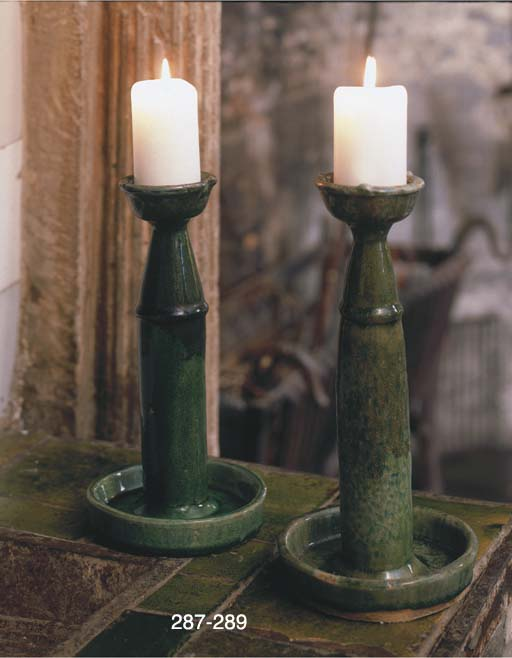 A SET OF SIX GREEN-GLAZED POTT