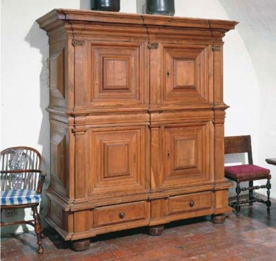 A GERMAN WALNUT SCHRANK