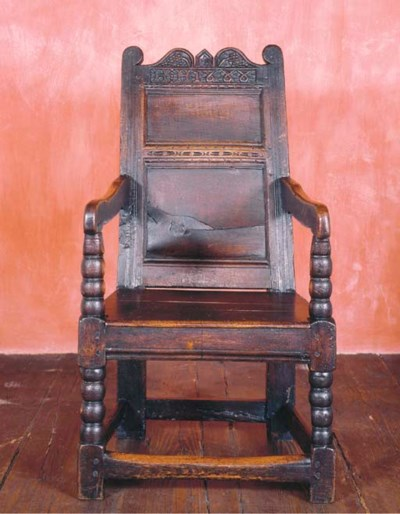 A JAMES II OAK OPEN ARMCHAIR
