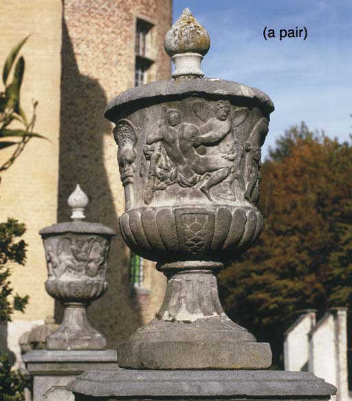 A PAIR OF STONE URNS WITH MYTH