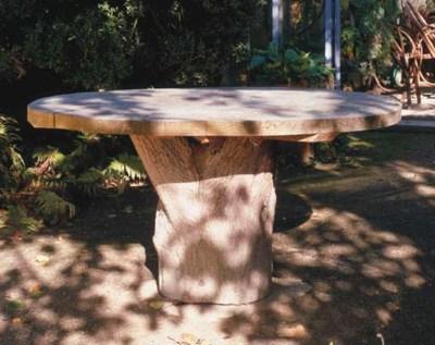 AN OAK GARDEN TABLE