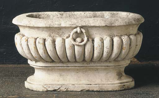 A FRENCH OVAL CARVED STONE BAS