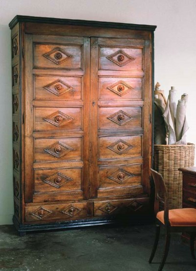 AN ITALIAN WALNUT CUPBOARD