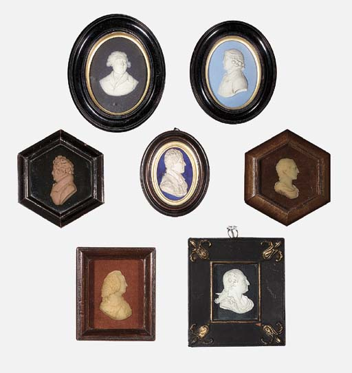 A GROUP OF SEVEN BISCUIT PORCE