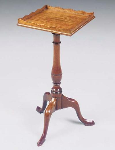 A MAHOGANY TRIPOD TABLE OF GEO