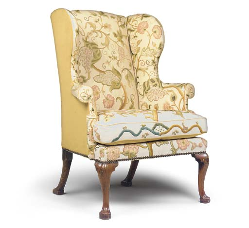 A GEORGE II ASH WING ARMCHAIR