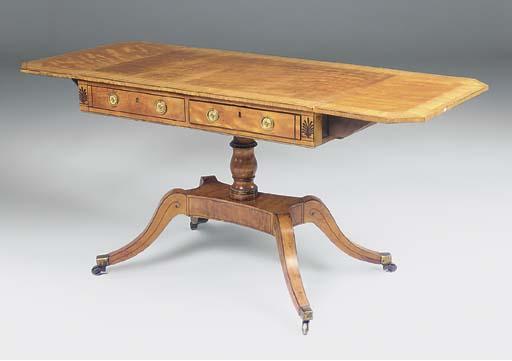 A LATE GEORGE III SATINWOOD SOFA TABLE