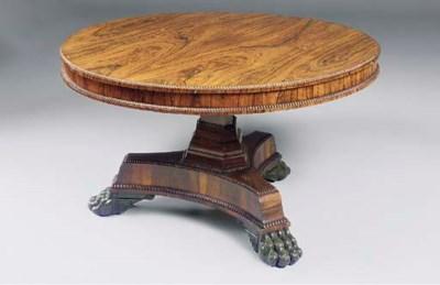 A REGENCY ROSEWOOD CENTRE TABL