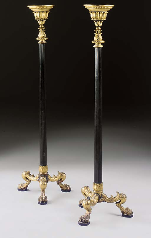 A PAIR OF GEORGE IV EBONISED AND PARCEL-GILT TRIPOD TORCHERES