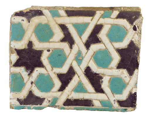 AN INCISED POTTERY RECTANGULAR TILE