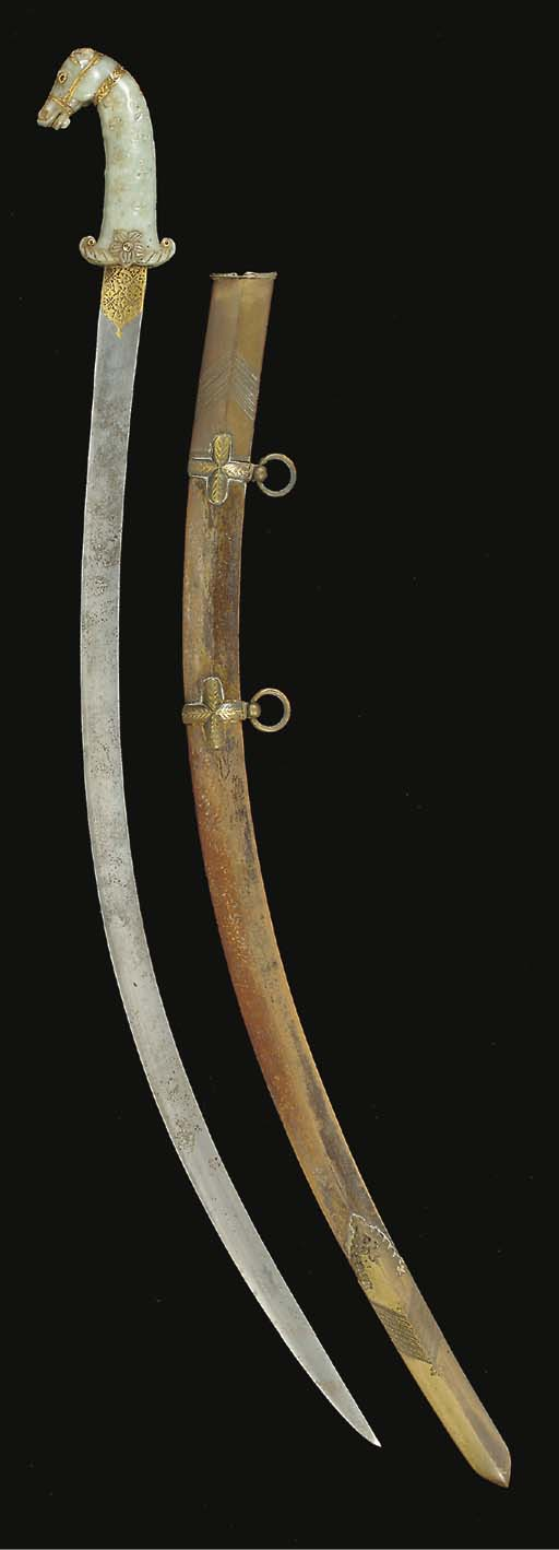 AN INDIAN JADE HORSE HEAD HILT