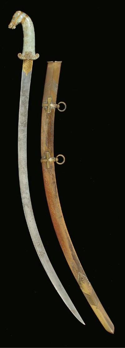 AN INDIAN JADE HORSE HEAD HILT