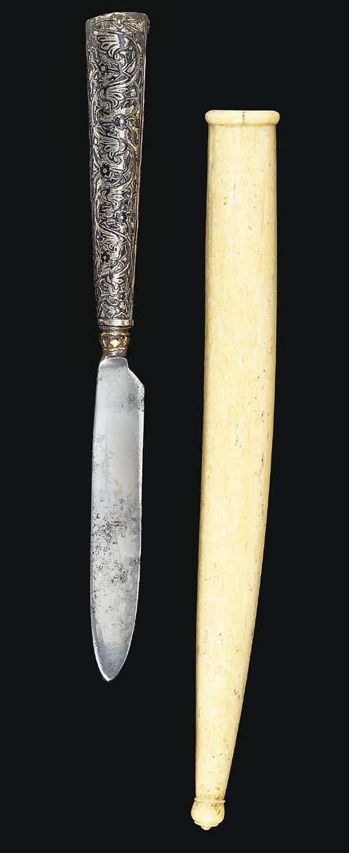 AN OTTOMAN SILVER KNIFE HILT WITH WALRUS IVORY SHEATH
