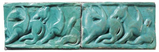 TWO KASHAN MOULDED TURQUOISE GLAZED POTTERY TILES