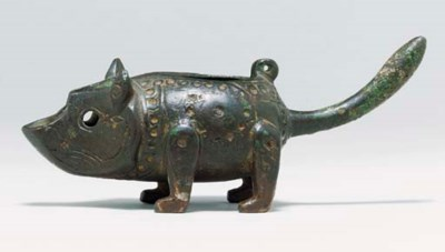 A KHORASSAN BRONZE OIL LAMP