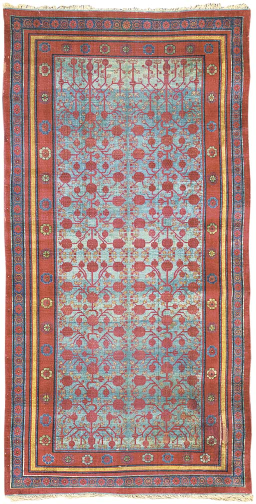 A SILK YARKAND CARPET