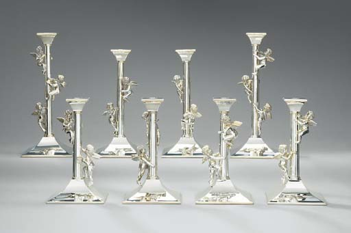 A set of eight silver candlest