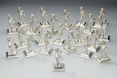 A set of twenty-two silver pla
