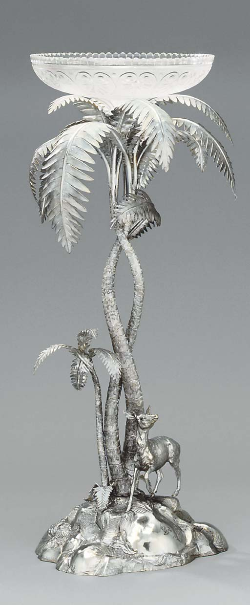 A Victorian silver and glass centrepiece