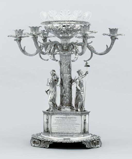 A William IV silver candelabru