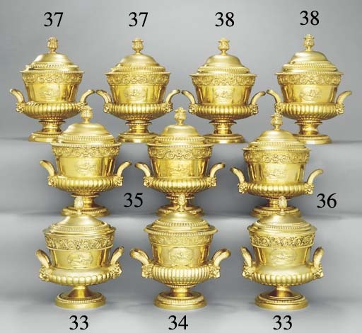 Two George III silver-gilt cups and covers