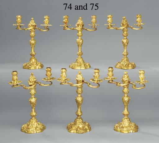 A George II and a George III silver-gilt candelabrum