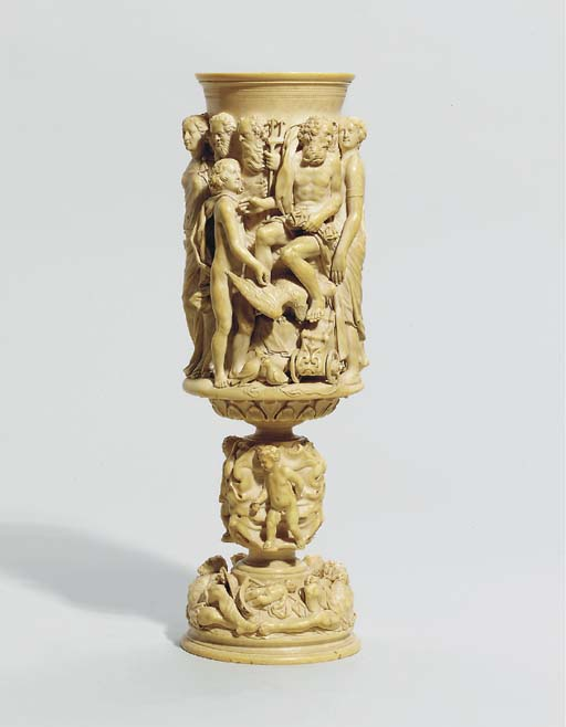 A CARVED IVORY CUP DEPICTING T
