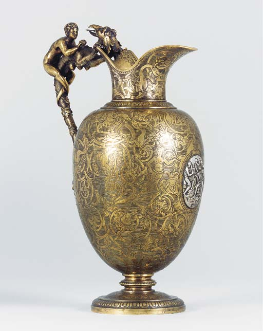 AN ENGRAVED BRONZE EWER