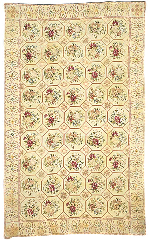AN ENGLISH NEEDLEWORK CARPET