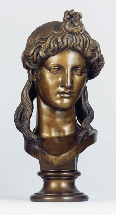 A BRONZE BUST OF APOLLO