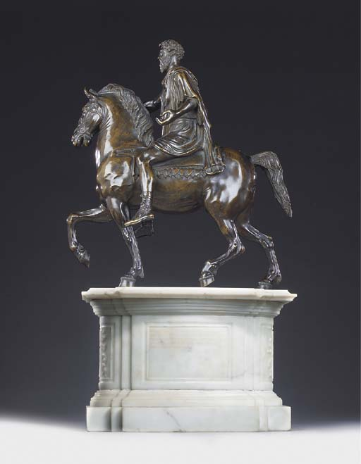 A BRONZE EQUESTRIAN GROUP OF M