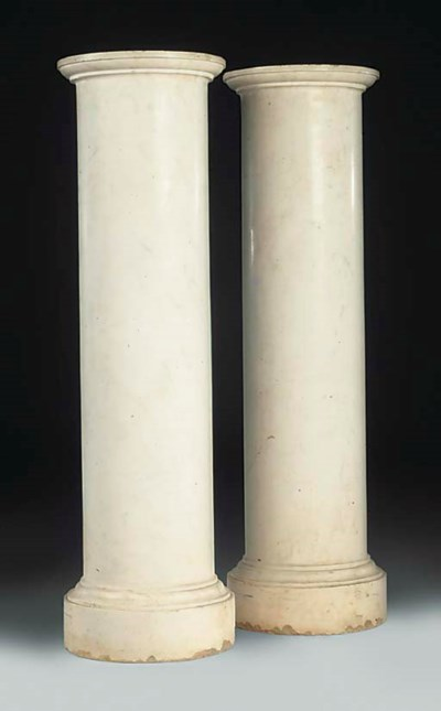 A PAIR OF CYLINDRICAL WHITE MA