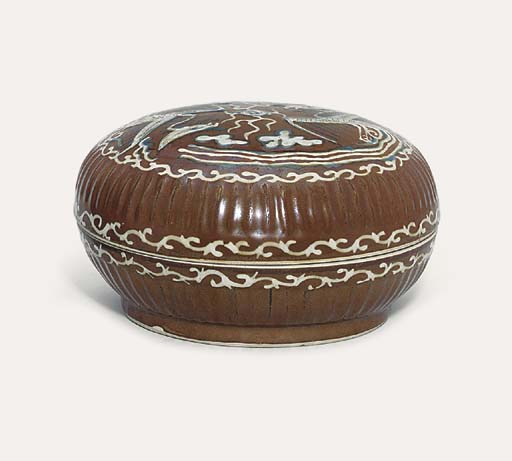 A BROWN-GLAZED SLIP-DECORATED