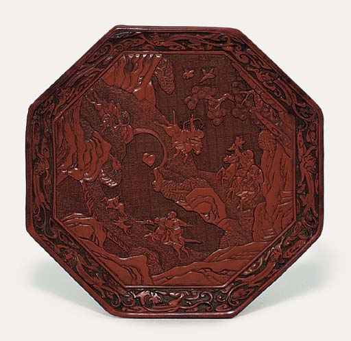 A CARVED RED LACQUER OCTAGONAL