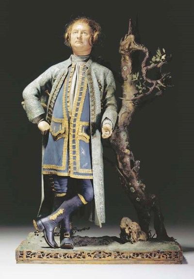 A PAINTED CLAY FIGURE OF DAVID
