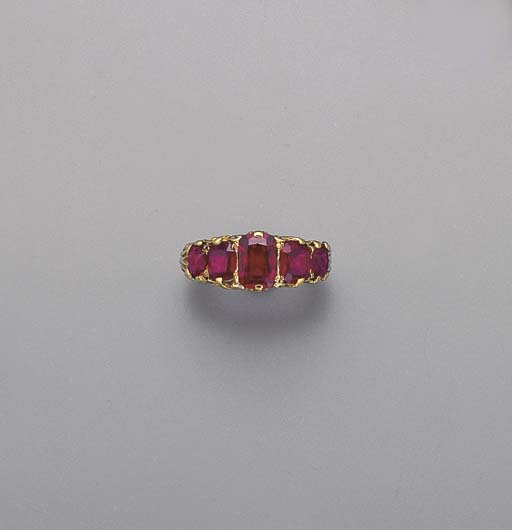 AN ANTIQUE RUBY FIVE-STONE RIN