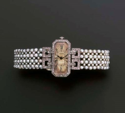 A LADY'S ART DECO DIAMOND AND