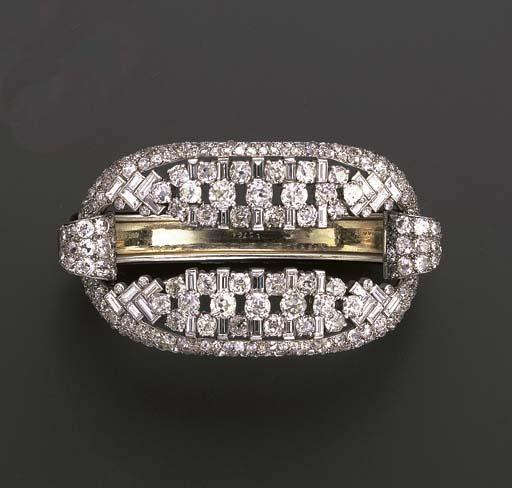 A DIAMOND AND BLACK ENAMEL BAN